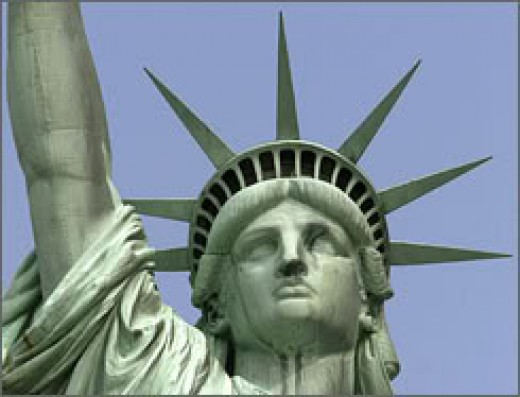 Here she is, asking for the tired, the poor, the huddled masses yearning to breathe free, and the wretched refuse from other shores.  Jeezy creezy, but she's perky.