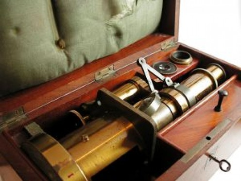 Brass microscope in case, much like one found in various Holmes Museums.