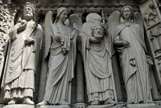 Saint Denis, Bishop of Paris, holds his head up high even after being beheaded