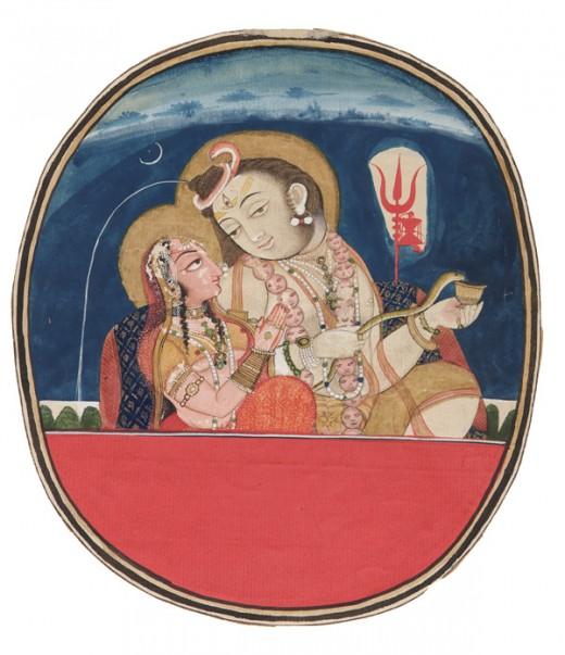 Shiva con Parvati.  Shiva se representa con tres ojos, con la luna creciente en la cabeza, el Ganges fluye a través de su pelo enmarañado, vestido con adornos de serpientes y un collar de cráneo, cubierto de cenizas y Trisula y Damaru se ven en el fondo.