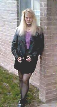 Black leather, black stockings, black studded shoes, and ah, favorite purple shirt, black studded collar and my heavy metal blonde locks ready to ROCK!
