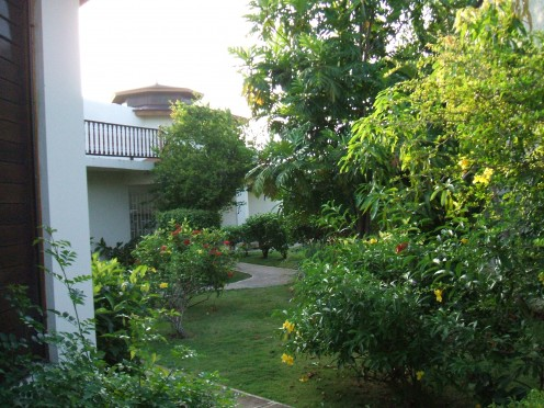 The walkways wind through beautiful well-kept gardens of flowers and fruit trees.  Also a bird watchers dream in the early morning late afternoon hours.