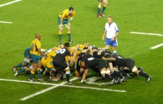 The All Blacks and Wallabies contest a rugby union scrum