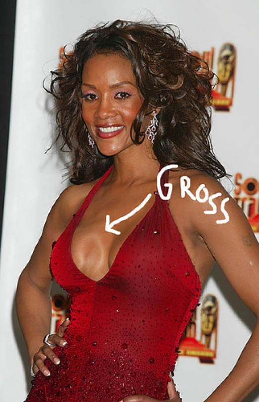 Vivica showing off her dented boob on the red carpet.