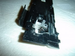 Constructed a power button using the broken piece from original flimsy button.