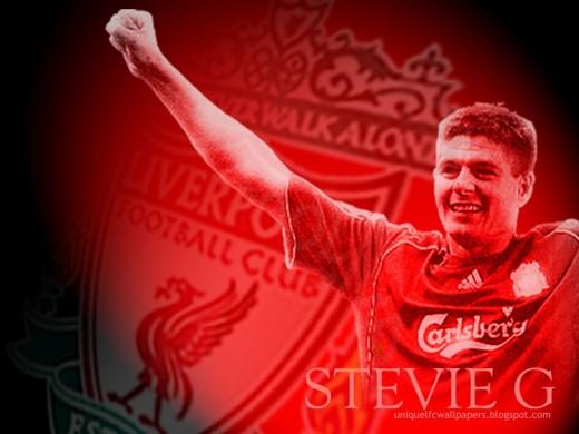 Steven Gerrard Lifting His Arms In Triumph Wallpaper