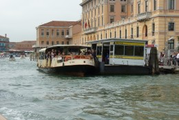 "A water bus on the Grand Canal at a ""bus stop""."
