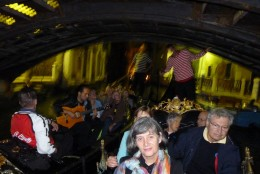 Our gondola ride with music in the gondola beside us as we pass under a bridge.