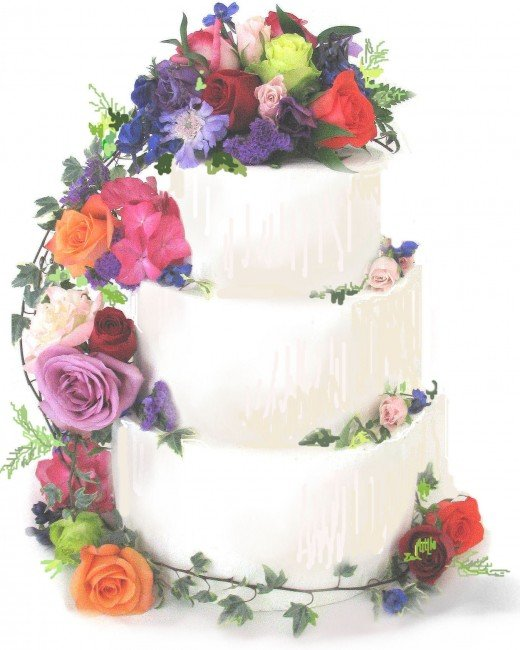 Mulit colored fresh flowers make this cake festive for any color scheme.