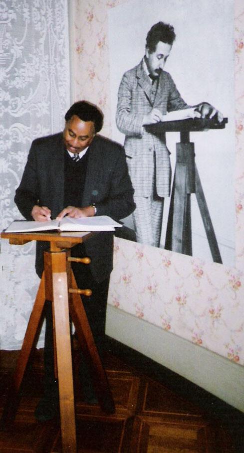 Dr. Ronald Mallett beside a photo of his hero Albert Einstein
