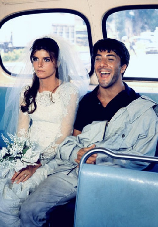 Katharine Ross and Dustin Hoffman, in The Graduate, make their getaway on a local bus