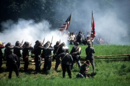 Confederate soldiers advance, Civil War battle reenactment