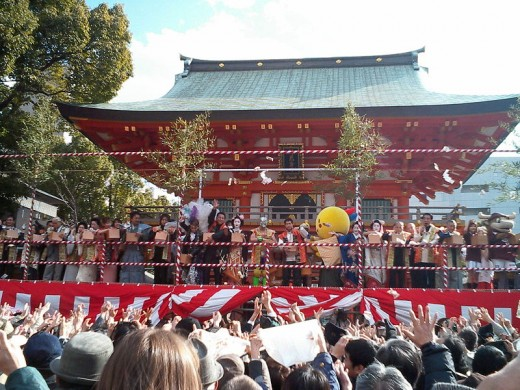 People throwing beans at the Setsubun Festival