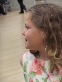 My daughter looking confident at the Blue & Gold Summer Ball, wearing April Martin earrings she bought herself.
