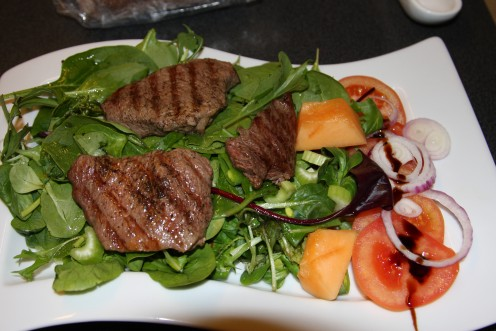 This was just fantastic. Steak with mixed salad a little galiano melon, tomato and a touch of balsamic,oil cream.