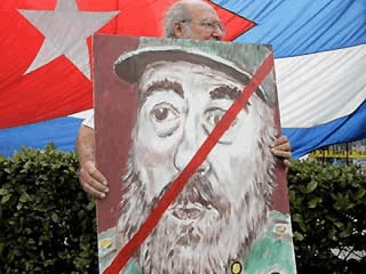 Feb. 19: Alfredo Rey carries an anti-Castro poster in the Little Havana neighborhood in Miami as Cuban-Americans celebrated the news of Fidel Castro's resignation
