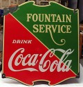 A porcelain Coca-Cola advertisement