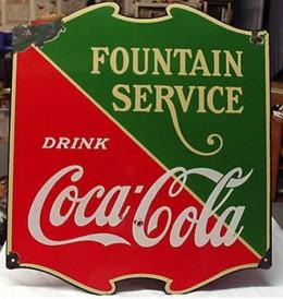 A porcelain Coca-Cola advertisement