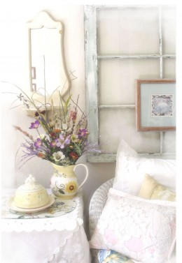 A vignette in the corner of a room where everything is carefully arranged to work with each other. The antique window, the old lace, etc., coordinated and working around the pitcher of dried flowers.