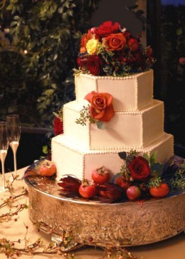 This fall cake included miniature fruit in the decoration with fall leaves and dark red roses.