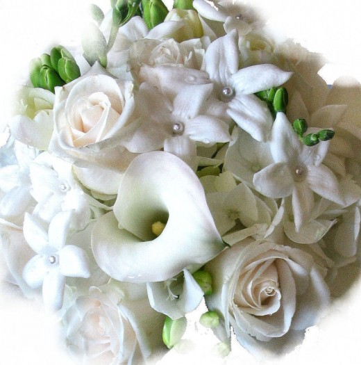 Tiny pearls dot the centers of this stephanotis bouquet.