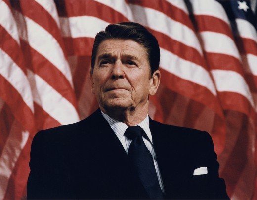 US President Ronald Reagon with a colorful red and white stripes in the background
