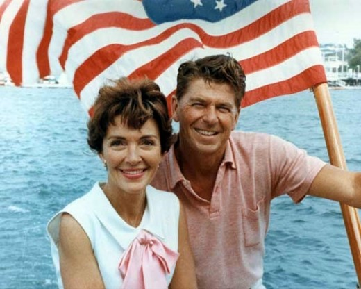 220 x 176 14.1 KB example of high quality image with former US President Reagon and his lovely wife with an American flag and water behind them
