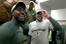 CHICAGO, IL - Jan 23, 2011 Aaron Rodgers with Greg Jennings of the Green Bay Packers celebrate the 21-14 victory against the Chicago Bears in the NFC Championship Game