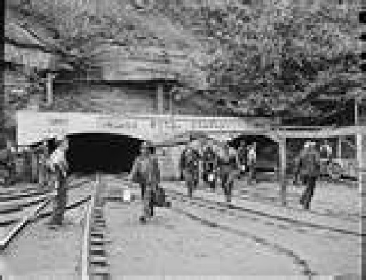 Miners working the mine portal in Wheelwright