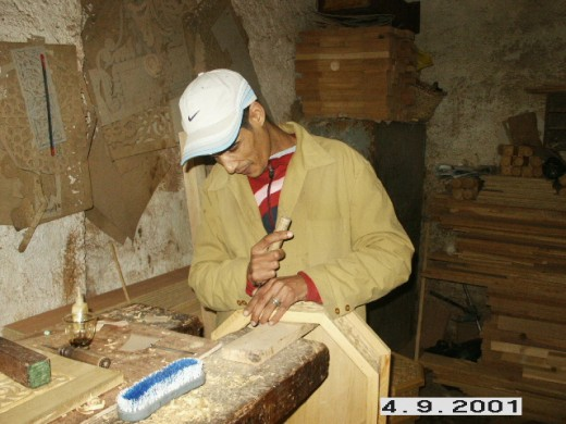 Craftsman working with wood in the Old Medieval City of Fes, Morocco.