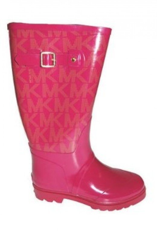 The Michael Kors logo consists of an M and a K that share a line. These Michael Kors rainboots use the logo as their main decorative theme.