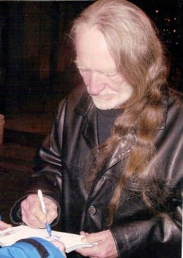 Willie Nelson signing autographs at Westbury Music Fair, Long Island, New York