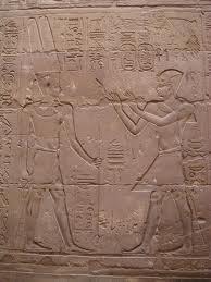Etching of Amun-Ra (left)