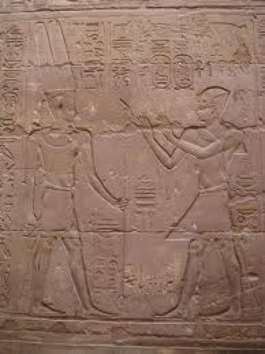 Etching of Amun-Ra (left)