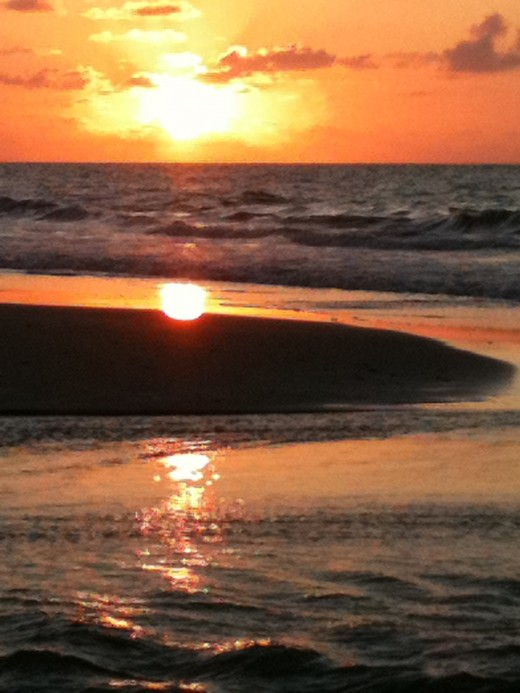 A beautiful picture of a sunrise on the beach can leave you breathless and can be your focal point as you meditate.