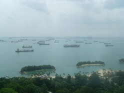 Some beaches on Sentosa Island with many ships in the distance