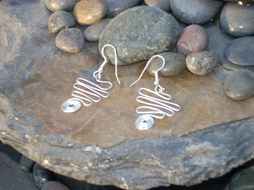 Silver wire is a perfect material for making earrings. I made these funky spiral earrings with 20 gauge dead-soft wire.