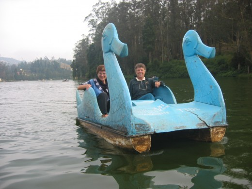 Riding a swan pedal boat on a lake in the cool southern mountains. This is a great area for hiking and visiting tea plantations.
