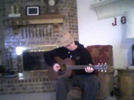/\ Thinks that he is Woody Guthrie.