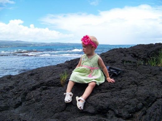Several of the beaches on the Big Island are lined with lava rock instead of sand.  My baby Aleana enjoyed it, she felt safer from the water. She was the only one of my four kids we got to bring. I am definitely wanting all my children to next time.