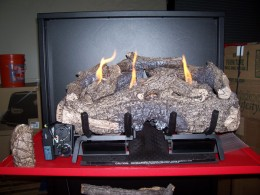 ceramic logs placed on the g10 vent free gas fireplace realfyre burner.