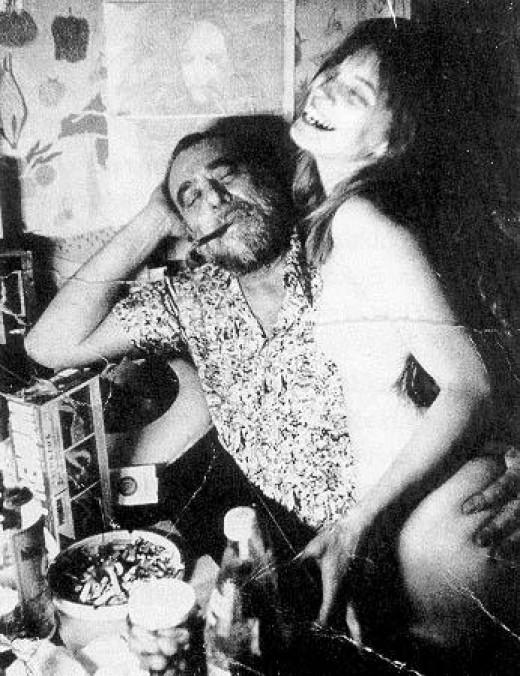 Charles Bukowski with naked girl