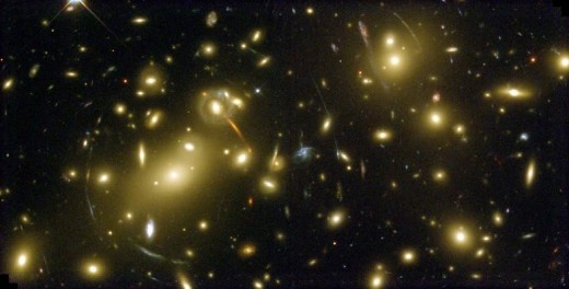 Gravitational Lensing in the Galaxy Cluster Abell 2218.  The circular streaks of light are gravitational lensing effects.