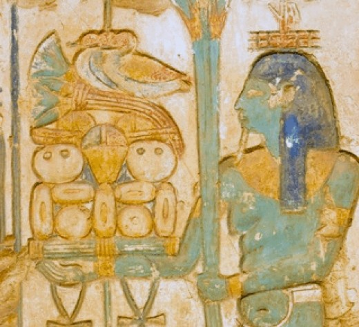 Blue Isis Godess With What Looks To Be Like Pita Bread.