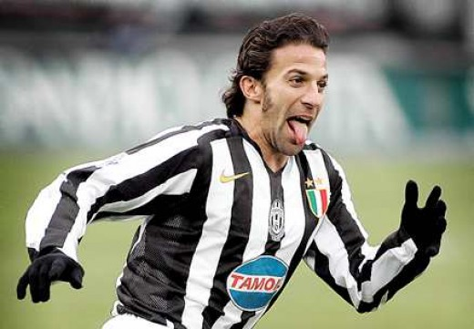 Alex Del Piero celebrates after scoring a goal sticking out his tongue.