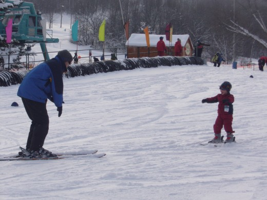 "A 3 Year Old in a special ""Wee Ski"" program: there is one instructor per student."