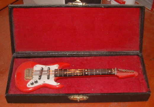 This is a miniature guitar that I bought for my son in Merrickville one day.