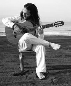 Typical sitting position for flamenco guitarists.