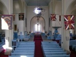 The interior of Canongate Kirk showing the light blue decor