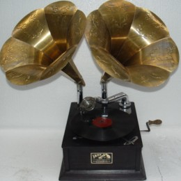 A early wind up phonograph with two horns for more sound volume and being able to cover more area so a larger crowd could listen. Now, being with the crowd that listened to the latest music, and danced the latest dances was the new social need